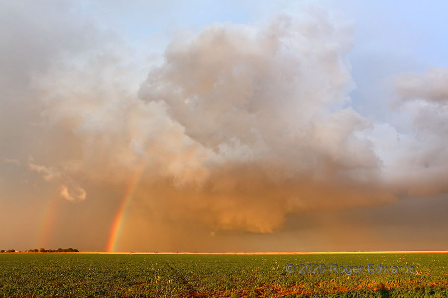 The Beauty of Atmospheric Violence (sunset supercell with wall cloud & double rainbow)